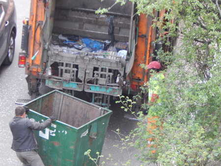 Garbage collection in the city courtyard by car