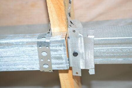 Mounting units for the metal profile for drywall