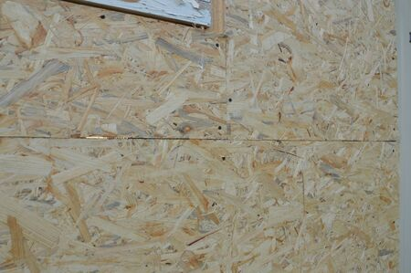 Cladding wood chipboards at the home