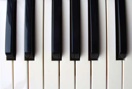 Piano keyboard closeup photo