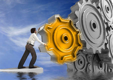 mechanical engineering: Businessman Turning a Gear