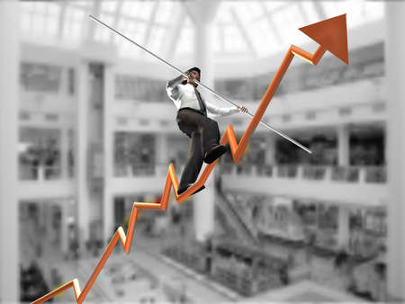 Businessman on a finance graphic aiming for the top  photo