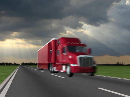 Red truck on blurry asphalt road over blue cloudy sky background photo
