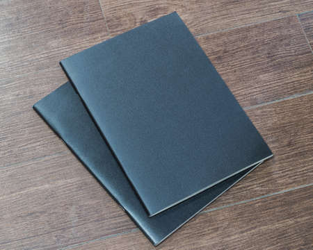 Book mockup blank black A4 leather cover for magazine, booklet, brochure, menu, diary mock-up design template on wooden table background 版權商用圖片
