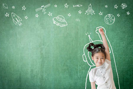 Kid's learning inspiration in successful education with creative imagination for back to school concept and STEM science technology engineering maths with doodle on aviation on green chalkboard