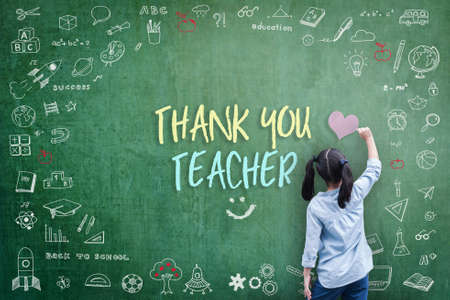 Thank You Teacher greeting for World teacher's day concept with school student back view drawing doodle of of learning education graphic freehand illustration icon on green chalkboard Stock Photo