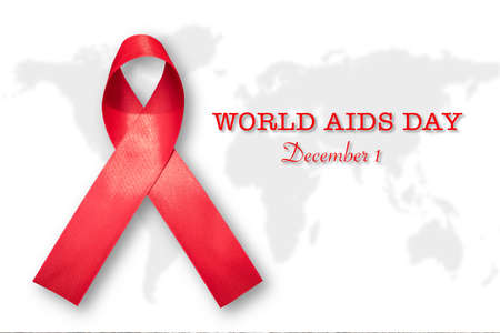 World aids day and national HIVAIDS and aging awareness month campaign concept with Aids red ribbon Symbolic satin bow isolated on white world map background with clipping path Stock Photo