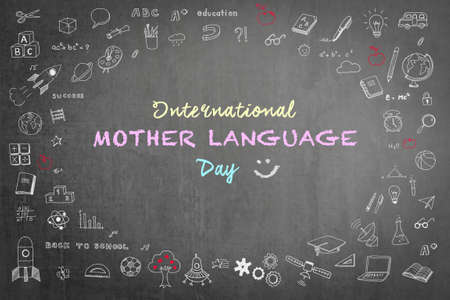 International mother language day on school black chalkboard background with doodle