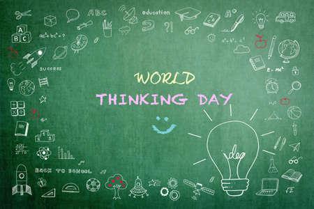 World Thinking Day greeting on teacher's chalkboard with big creative idea lightbulb thought on school or business chalkboard Stok Fotoğraf