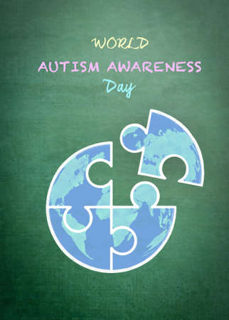 World Autism Awareness day with doodle of globe in puzzle jigsaw piece on school green chalkboard Stock Photo
