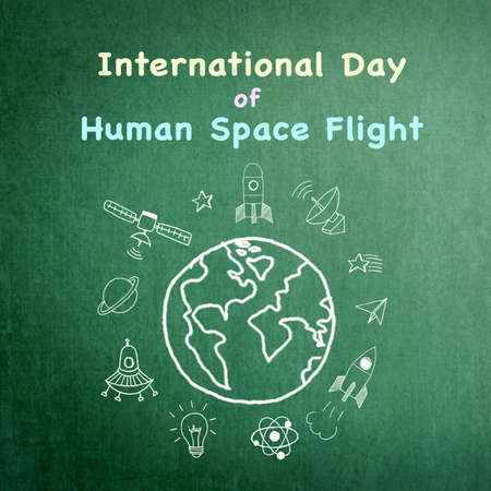 International day of human space flight announcement on grunge green chalkboard doodle drawing