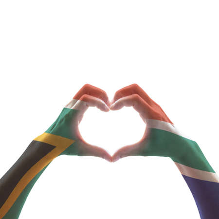 South Africa flag on woman hands in heart shape isolated on white background for national unity, union, love and reconciliation concept Imagens