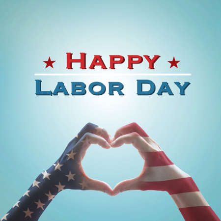 Happy labor day text message with America flag pattern on people hands in heart shaped on vintage blue sky background Stock Photo