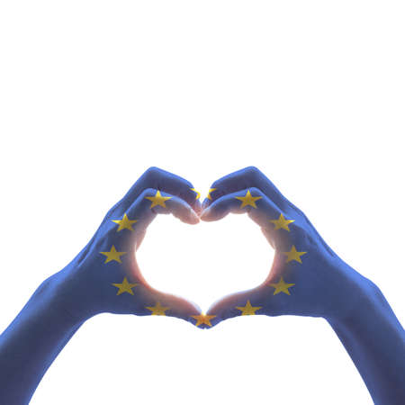 European Union flag pattern on people hands in heart shape isolated on white background Stockfoto