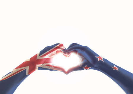 New Zealand flag on people heart shaped hands isolated on white background Stock Photo
