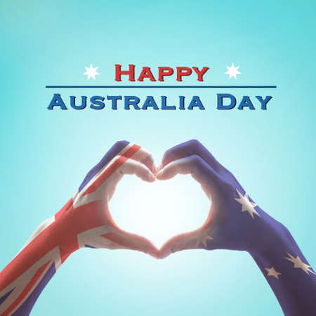 Happy Australia day with national flag on hands in heart shape  Stock Photo