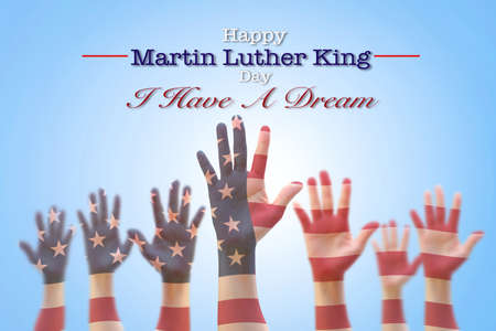 Happy Martin Luther King day, January 18th, I have a dream with American flag pattern on people hands raising up Stockfoto