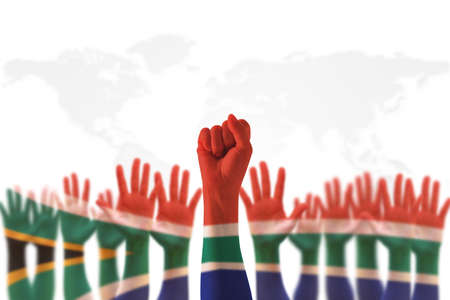 South Africa national flag on leader's fist hands (clipping path) for human rights, leadership, reconciliation concept