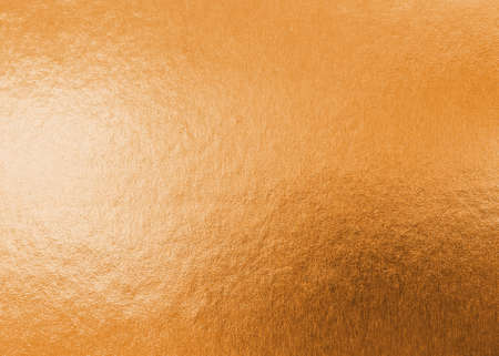 Copper gold texture metallic wrapping foil paper shiny orange background for wall paper decoration element Standard-Bild