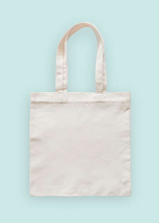 Tote bag canvas fabric cloth eco shopping sack mockup blank template isolated on pastel mint blue background (clipping path)