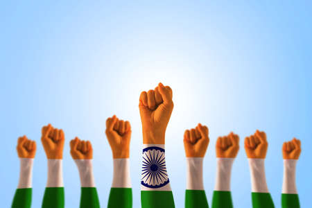 India national flag pattern on leader's fist isolated on blue sky for Human equal rights, labor day concept