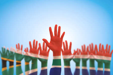 South Africa national flag on people's hands raising up  for human rights, leadership, reconciliation concept