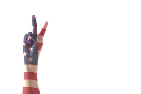 Victory symbol and American flag pattern on people's hand with for USA  election day concept Reklamní fotografie