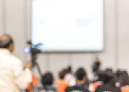 Seminar blur background training workshop event video recording camera man, speaker lecturer giving business talk, presentation speech or educational conference with audience in auditorium lecture hall