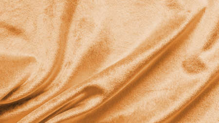 Copper gold velvet background or golden yellow velour flannel texture made of cotton or wool with soft fluffy velvety satin fabric cloth metallic color material
