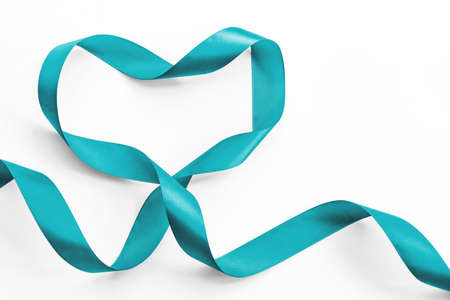Teal ribbon awareness in heart shape isolated on white   symbolic bow color for Ovarian Cancer, Polycystic Ovary Syndrome (PCOS) disease, Post Traumatic Stress Disorder (PTSD)