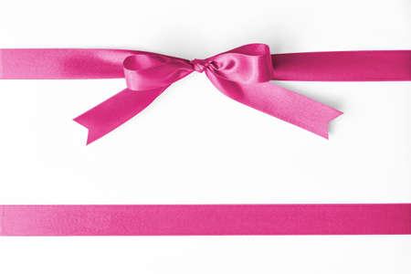 Pink satin ribbon stripe fabric bow isolated on white background