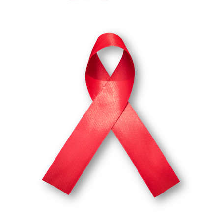 Aids red ribbon for World aids day and national HIVAIDS and aging awareness month concept. Symbolic satin bow isolated on white background