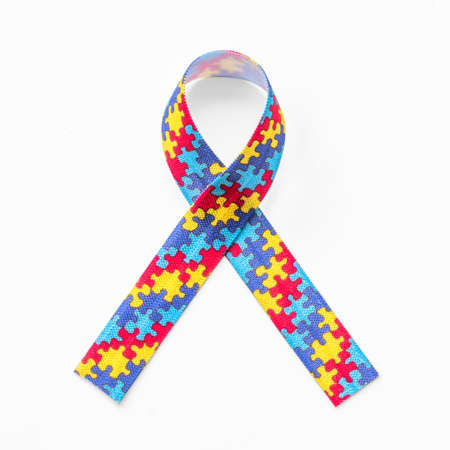 Autism awareness ribbon in puzzle or jigsaw pattern   for World Autism Awareness day, mental health care concept for autistic child person support and family nursing care Stock Photo