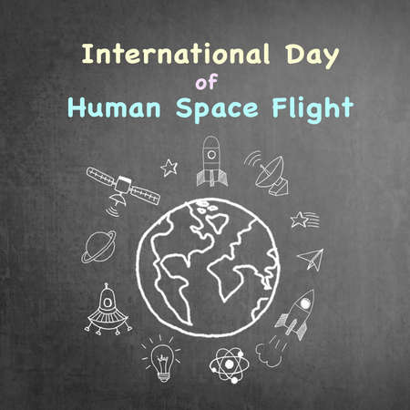 International day of human space flight announcement on grunge black chalkboard doodle drawing