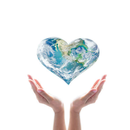 Green planet in heart shape over woman human hands isolated on white background.