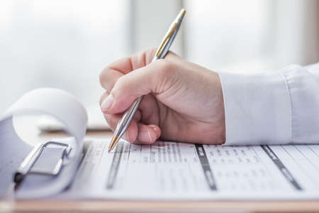Applicant filling in company application form document applying for job, or registering claim for health insurance Stock Photo - 116284443