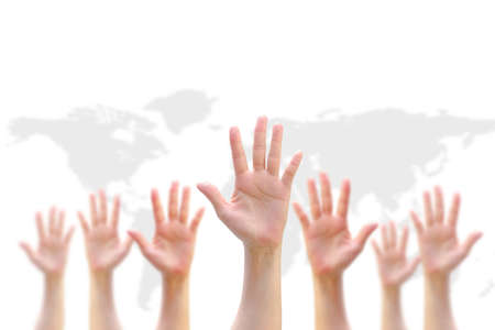 Many people women hands raising up on world map background showing vote, volunteer participation, rights equality concept Stock Photo