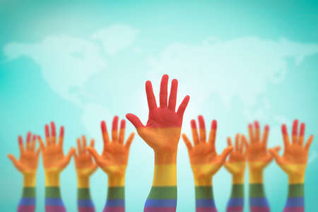 LGBT equal rights movement and gender equality concept with rainbow flag on people's hands up