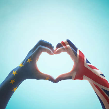 United kingdom great Britain and EU European union flag on people hands in heart shape on mint background