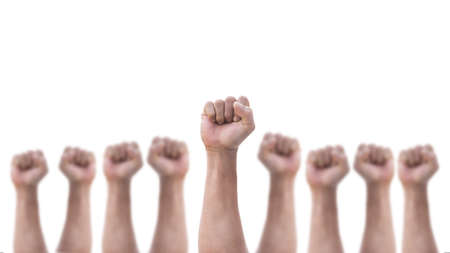 Empowering people power, human rights and May day, labor day concept with male clenched fist of man's hand group isolated on a white background