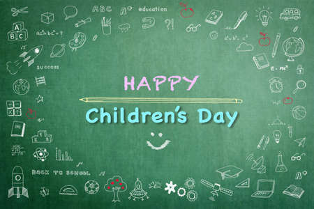 Happy childrens day greeting with doodle on green chalkboard for International childrens day