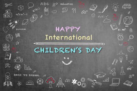 Happy international childrens day greeting with doodle on black chalkboard  版權商用圖片