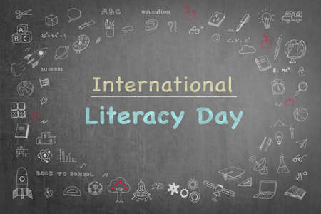 International literacy day on black chalkboard with doodle