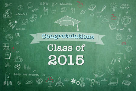 Graduation congratulations class of 2015 greeting announcement for educational congrats card with student's doodle hat on school green teacher's chalkboard background Stock Photo