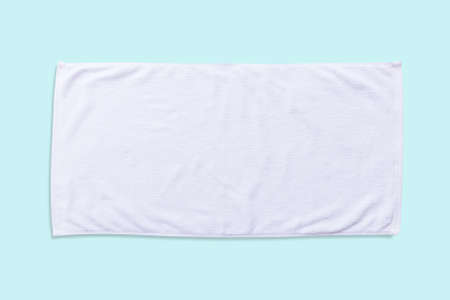 White beach towel mock up isolated with clipping path on blue background, flat lay top view Stock Photo - 124855446