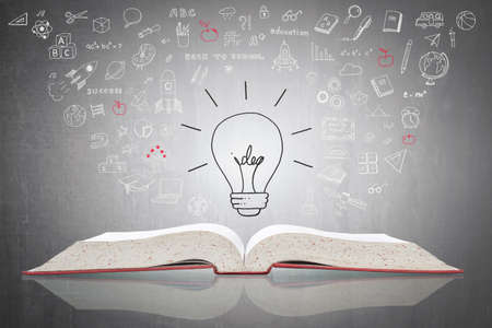 Innovative light bulb on book with doodle for World intellectual property day and education concept