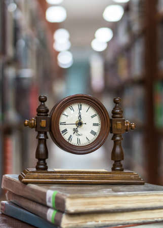 Old Alarm clock on stack of book with blur abstract background educational library Stok Fotoğraf