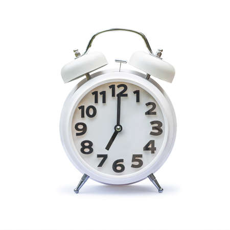 White alarm clock at 7 seven oclock isolated on white background (clipping path) Reklamní fotografie