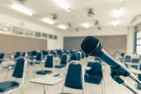 Microphone voice speaker in school lecture hall, seminar meeting room or educational business conference event for host, teacher or coaching mentor