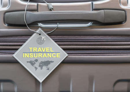Travel insurance protection plan for airline safety and security with tag on passenger suitcase luggage handle Banco de Imagens
